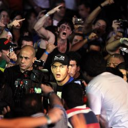 UFC welterweight Paulo Thiago, a member of the elite police squad BOPE, received a raucous ovation from the crowd.