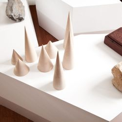 Hand turned maple wood cones by Jung's husband.