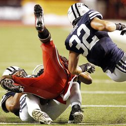 Utah Utes wide receiver Reggie Dunn (14) is tackled by Brigham Young Cougars defensive back Mike Hague (32) in Salt Lake City  Saturday, Sept. 15, 2012.