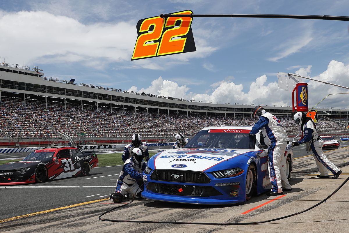Austin Cindric, driver of the #22 CarQuest Auto Parts Ford, pits as Tyler Reddick, driver of the #31 Bommarito Automotive Group Chevrolet, drives pit road during the NASCAR Xfinity Series Alsco Uniforms 300 at Charlotte Motor Speedway on May 29, 2021 in Concord, North Carolina.