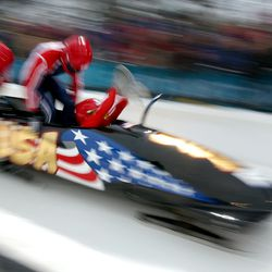 Team USA-2 jumps into their sled during their fourth and final run of the four-man bobsleigh at the Utah Olympic Park on Saturday, Feb. 23, 2002.