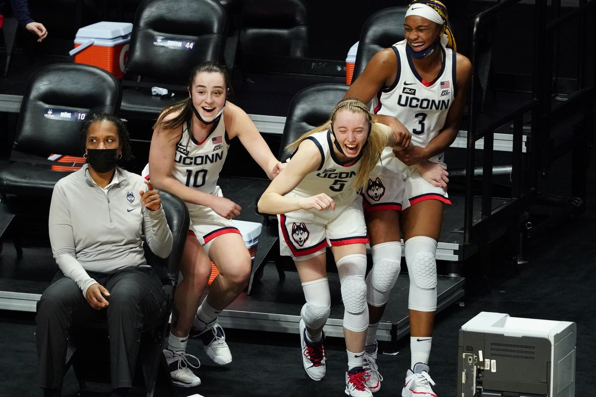 UConn Huskies guard Nika Muhl (10), guard Paige Bueckers (5) and forward Aaliyah Edwards (3) react after a play on the court against the Marquette Golden Eagles in the second half at Mohegan Sun.