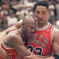 The Chicago Bulls' Michael Jordan collapses in the arms of teammate Scottie Pippen, right, at the end of Game 5 of the NBA Finals with the Utah Jazz Wednesday, June 11, 1997, in Salt Lake City. Jordan, fighting flu symptoms, scored 38 points as the Bulls beat the Jazz 90-88 to take a 3-2 lead in the series. (AP Photo/Susan Ragan)