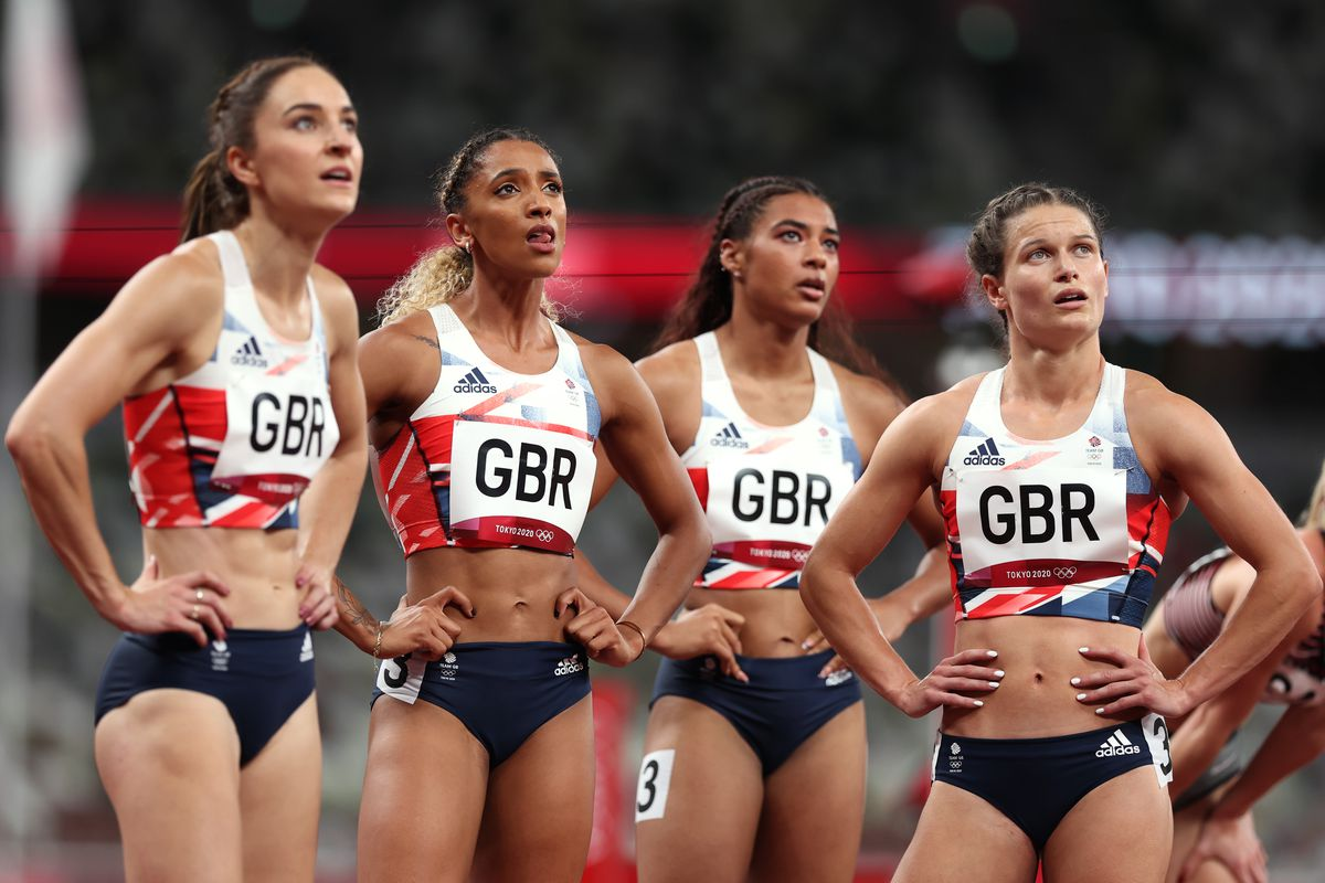 Emily Diamond, Laviai Nielsen, Zoey Clark and Nicole Yeargin of Team Great Britain look on after finishing third in the Women's 4 x 400m Relay heats on day thirteen of the Tokyo 2020 Olympic Games at Olympic Stadium on August 05, 2021 in Tokyo, Japan.