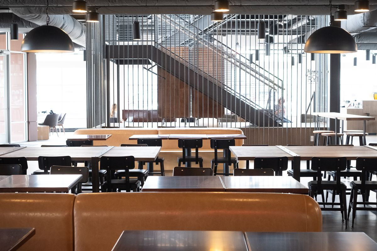 Downstairs inside Graze food hall, lots of seats and a stairway to the second floor