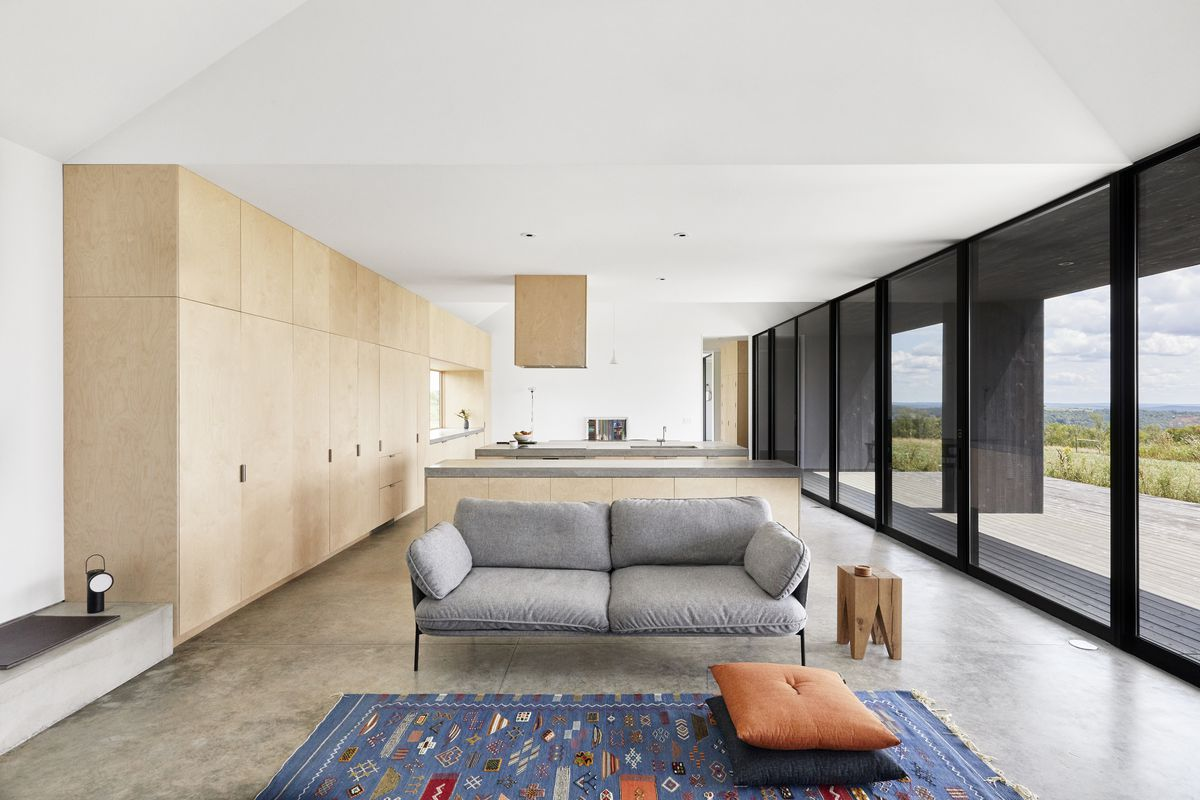 Living room with polished concrete floors.