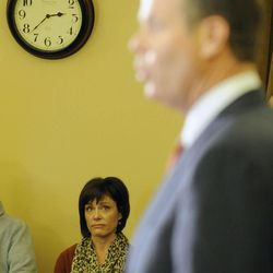 Utah Attorney General John Swallow's wife, Suzanne, listens as her husband announces his resignation during a press conference at the Capitol in Salt Lake City on Thursday, Nov. 21, 2013.