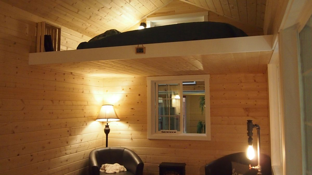 A living area below, and a loft above under the vaulted ceiling