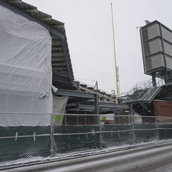 Wide view of the work taking place in the gap between the right field grandstand and the bleachers