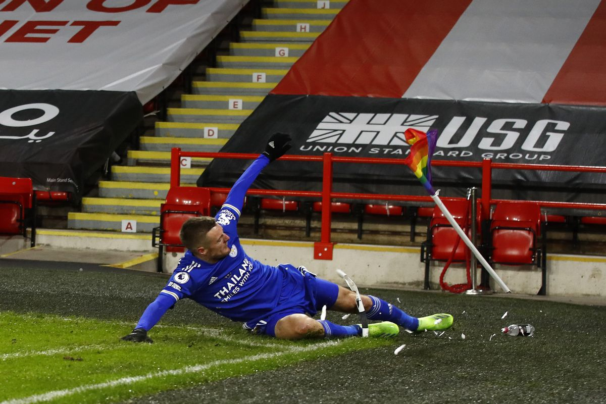 Jamie Vardy slides into the rainbow flag at the corner of the field.