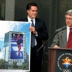 SLOC President and CEO Mitt Romney, announces a 500-Day Countdown Celebration to be held on September 26, 2000 at the Gallivan Center, during a press conference at the SLOC offices, Wednesday, September 6, 2000.  Here S.L. Mayor Rocky Anderson speaks while Mitt Romney and Scott Gibbons hold a rendering showing the 265' poster of Ogden figure skater Stephanie Rosenthal, that will be hung on the American Stores building/SLOC offices building.