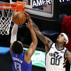 Utah Jazz guard Jordan Clarkson (00) blocks Dallas Mavericks guard Jalen Brunson (13) at the rim as the Utah Jazz and the Dallas Mavericks play an NBA basketball game at Vivint Smart Home Arena in Salt Lake City on Wednesday, Jan. 27, 2021.