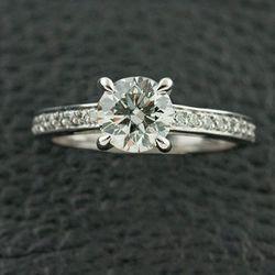 "<a href=""http://www.craigerdrake.com/index.htm"">Craiger Drake</a> .75 carat round diamond platinum ring, ~$3K."