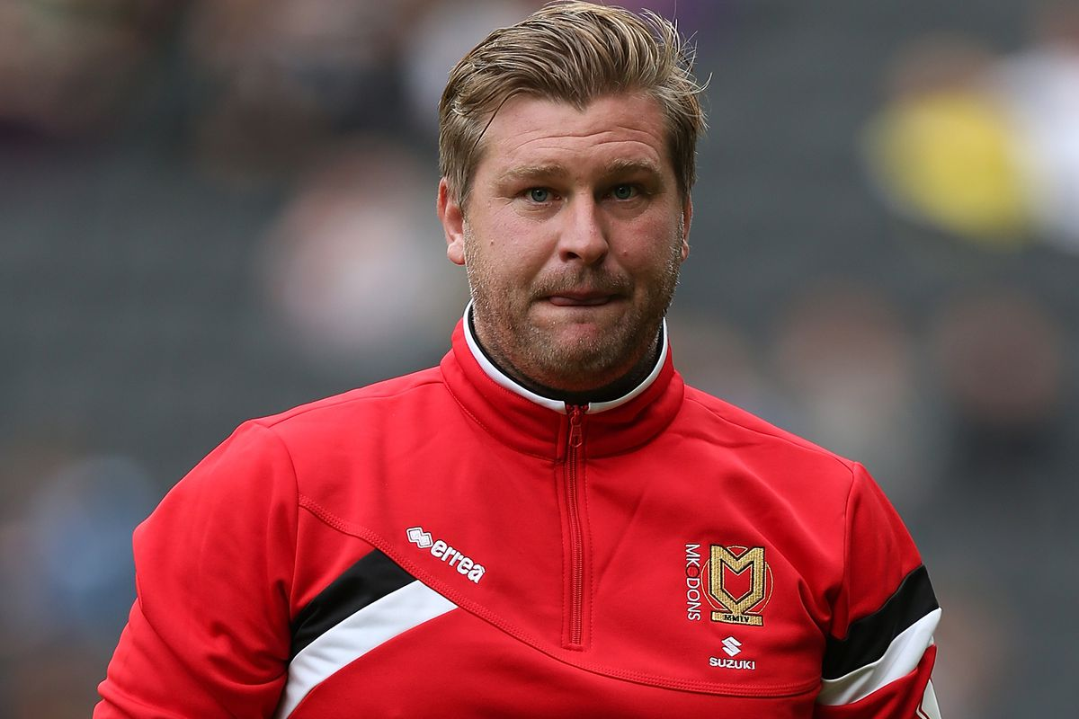 Karl Robinson's MK Dons are top of the Championship thanks to a 4-1 away victory over Rotherham United