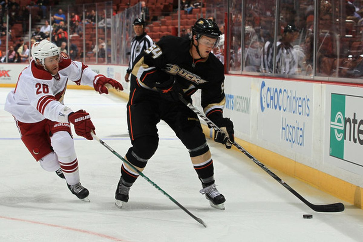 ANAHEIM CA - SEPTEMBER 21:  Cam Fowler #54 of the Anaheim Ducks is pursued by Danny Syvret #26 of the Phoenix Coyotes in the first period at Honda Center on September 21 2010 in Anaheim California.  (Photo by Jeff Gross/Getty Images)