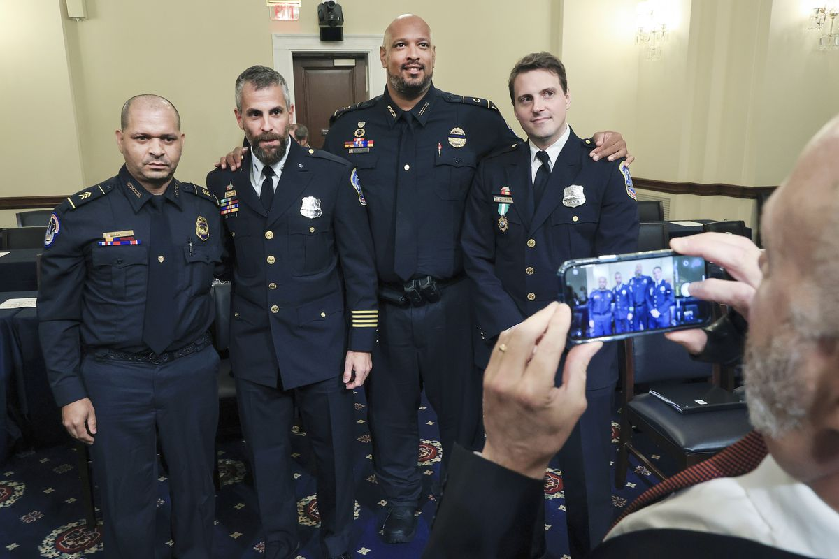 U.S. Capitol Police Sgt. Aquilino Gonell, from left, Washington Metropolitan Police Department officer Michael Fanone, U.S. Capitol Police Sgt. Harry Dunn and Washington Metropolitan Police Department officer Daniel Hodges, pose for a photo on Tuesday after testifying before the House select committee hearing on the Jan. 6 attack on Capitol Hill.