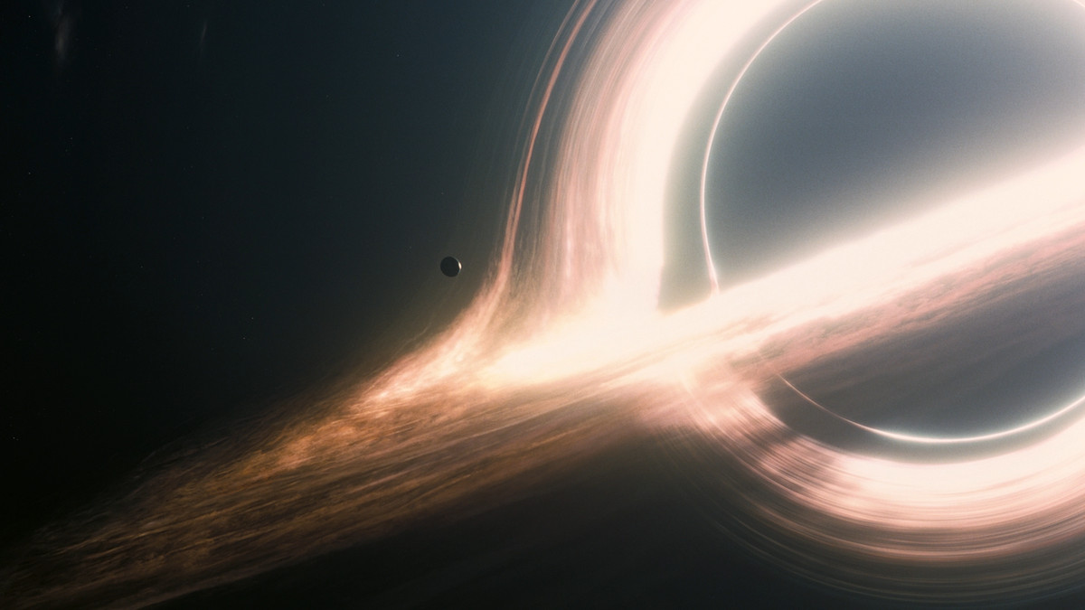 a planet hovers on the cusp of a black hole in Interstellar