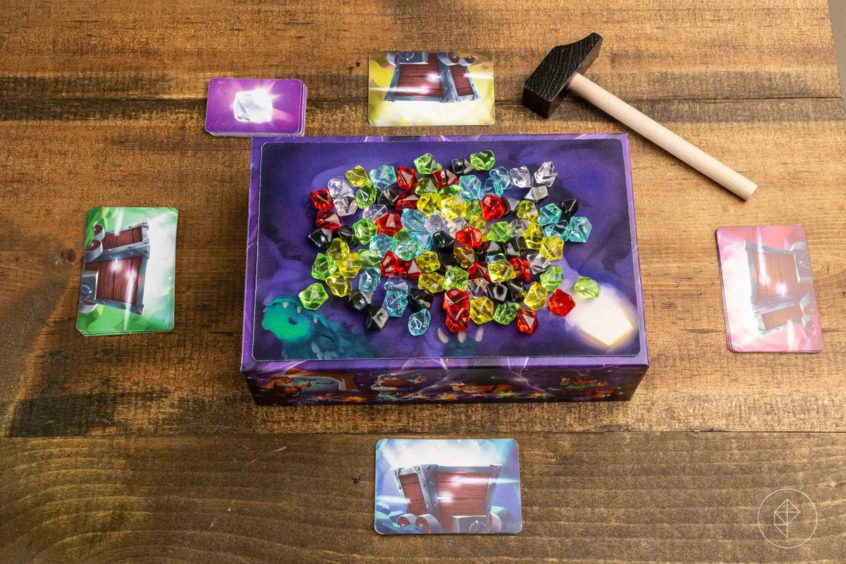 Hammer time set up for play. The box insert is place upside down, with a mousepad-like bit of cloth on top to hold all the gems quietly in place.