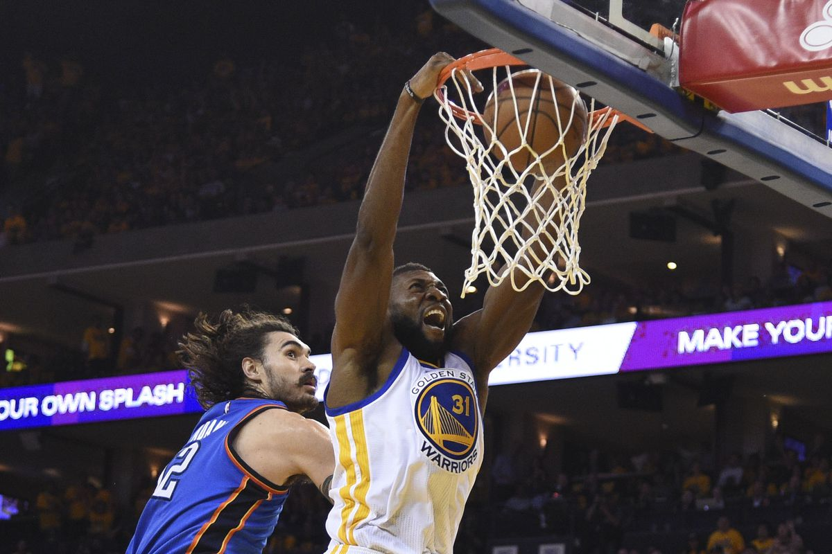 Festus Ezeli slams home two points while Steven Adams watches.