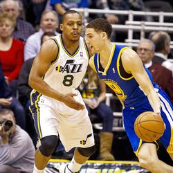 Jazz guard Randy Foye (8) follows Warriors guard Klay Thompson (11) during the first half of the NBA basketball game between the Utah Jazz and the Golden State Warriors at Energy Solutions Arena, Wednesday, Dec. 26, 2012.
