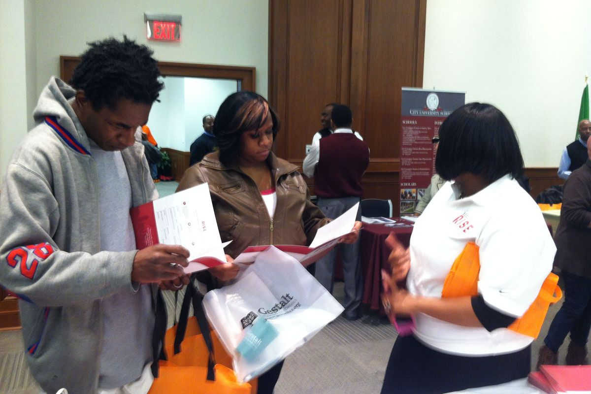 Parents talk to Memphis Rise employees about the new charter schools