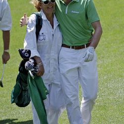 Keegan Bradley walks with his mother Kaye during the par three competition at the Masters golf tournament Wednesday, April 4, 2012, in Augusta, Ga.