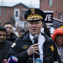 Chicago Police Cmdr. Don Jerome speaks to reporters as hundreds gather for a vigil in a parking lot in the 2000 block of South Wells in Chinatown, where Huayi Bian and Weizhong Xiong were shot to death, Wednesday, Feb. 12, 2020. Bian and Xiong were killed during an apparent robbery, for which Alvin Thomas faces two counts of first-degree murder.