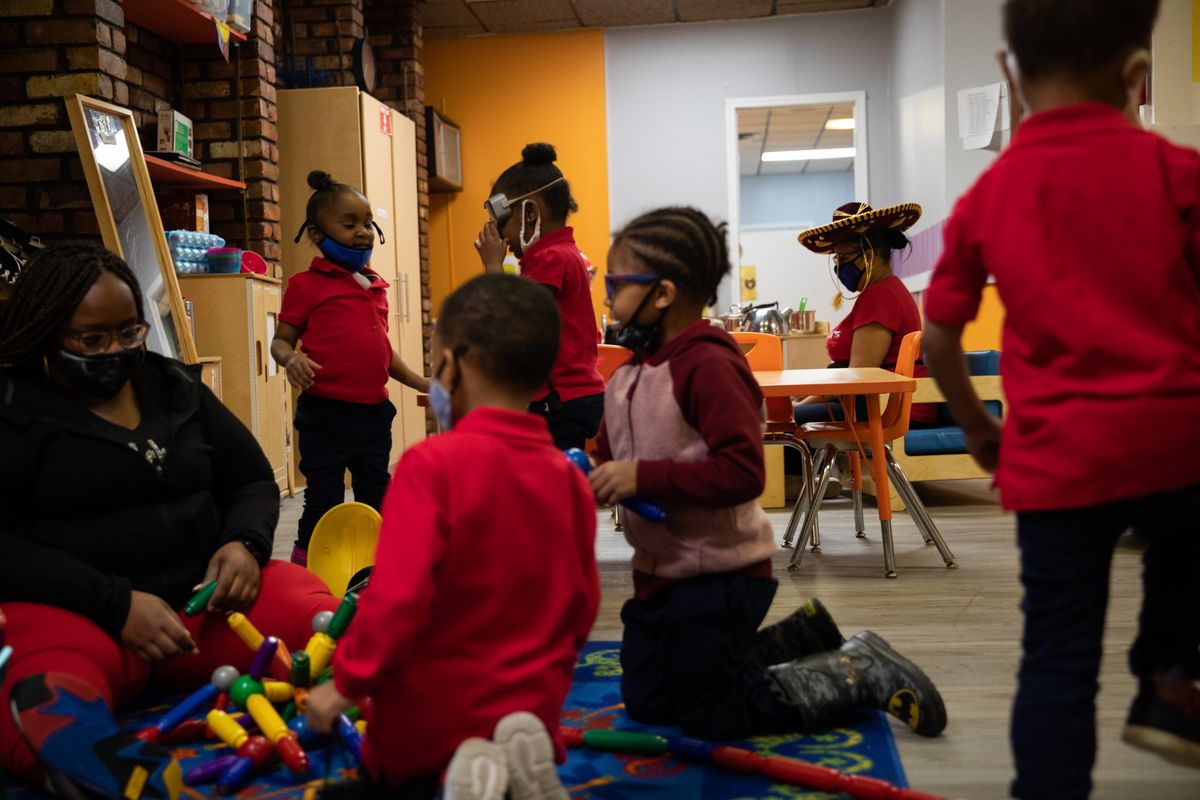 Preschoolers play with different toys and props after their painting activity at Little Scholars child care center.