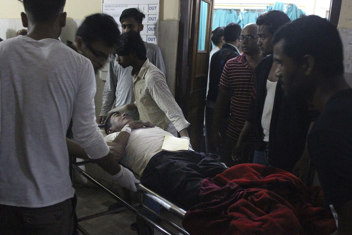 An Injured of rain storm from Bara district is being brought to a government hospital, in Birgunj, 136 kilometers (85 miles) from Kathmandu, Nepal, March 31, 2019. Officials say many people were killed and hundreds were injured by a rainstorm that swept s