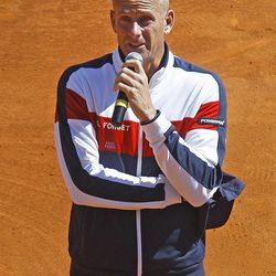 French team coach Guy Forget is overcome by emotion as he thanks the public after French  player Jo-Wilfried Tsonga was defeated by U.S. players John Isner, in the quarterfinal of the Davis Cup between France and U.S. in Monaco Sunday April 8, 2012.