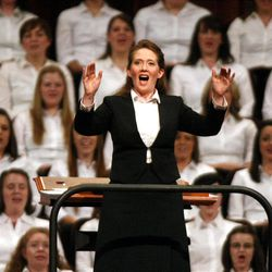 Emily Wadley directs the Relief Society Choir from Young Single Adult Stakes in Salt Lake during the General Relief Society Meeting at the Conference Center on Temple Square in Salt Lake City on Saturday, Sept. 29, 2012.