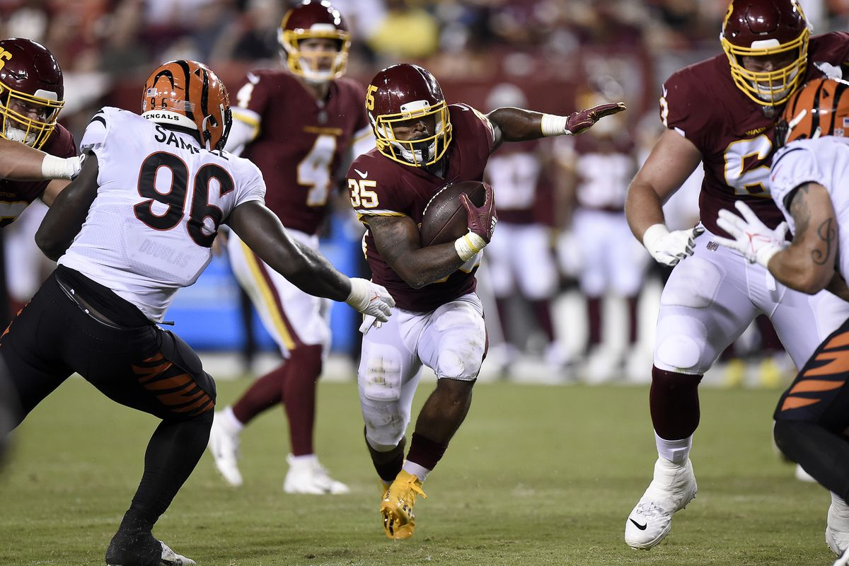Jaret Patterson #35 of the Washington Football Team rushes the ball in the second half during the NFL preseason game against the Cincinnati Bengals at FedExField on August 20, 2021 in Landover, Maryland.
