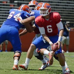 Florida quarterback Jeff Driskel (6) pitches the ball during the Orange and Blue NCAA college football game in Gainesville, Fla., Saturday, April 7, 2012.