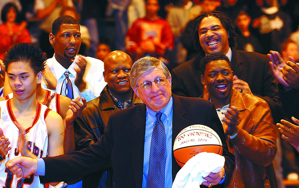 St. Joseph coach Gene Pingatore is surrounded by current and former players after his 700th win.