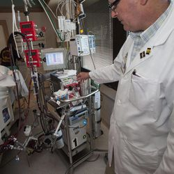 Dr. William Lynch, a cardiothoracic surgeon who directs the UI hospital's ECMO program, explains how an Extracorporeal Membrane Oxygenation machine, or ECMO, works as it treats a patient at University Hospitals Thursday, Aug. 23, 2012 in Iowa City, Iowa.  The UI hospital's strong and growing adult ECMO program draws patients from across the Midwest and sometimes from across the country.