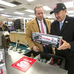 Gov. Gary Herbert holds a toy truck given to him by Timothy Griffith, president of Speedway LLCat the company's new store on Beck Street in Salt Lake City on Monday, Nov. 25, 2019.Speedway gas stations will now sell lower-sulfur Tier 3 gasoline. The fuel, brought to Utah by Marathon Petroleum, will not cost any additional money for motorists, yet its pollution reduction in emissions is the equivalent of taking four or five cars off the road.