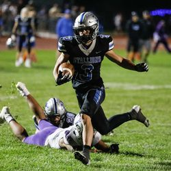 Stansbury's Nate Bushnell (3) runs past Tooele's defense for a touchdown during a high school football gameat Stansbury High School in Stansbury Park on Friday, Sept. 17, 2021.