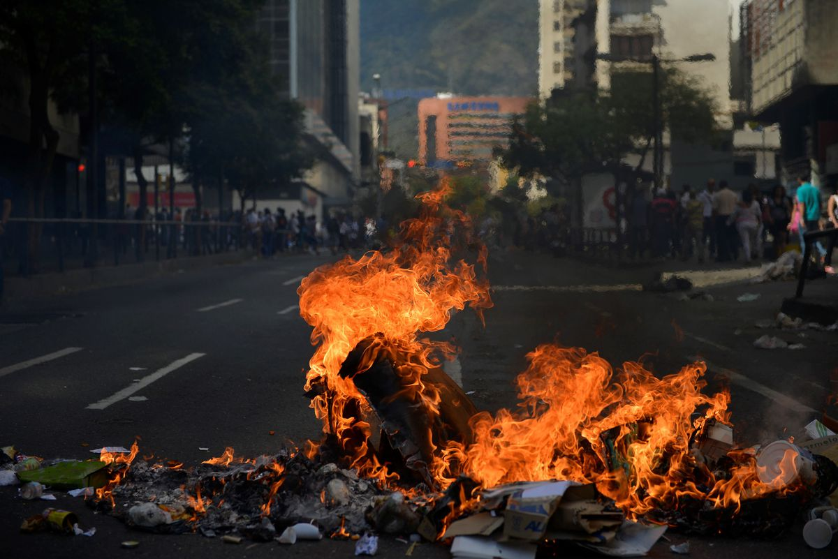 Venezuela burning barricade
