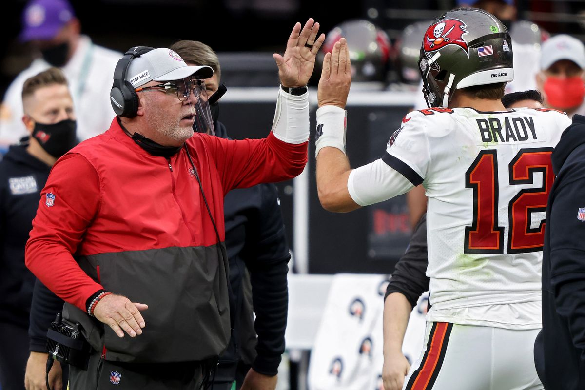 Head coach Bruce Arians and Tom Brady #12 of the Tampa Bay Buccaneers celebrate after scoring a touchdown in the second quarter against the Las Vegas Raiders at Allegiant Stadium on October 25, 2020 in Las Vegas, Nevada.