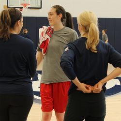 Breanna Stewart (43) talks with UConn assistants Marisa Moseley (L) and Shea Ralph (R).