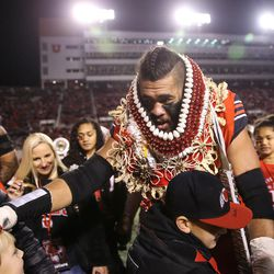 Utah Utes offensive lineman Salesi Uhatafe (74) greets people on the field during a ceremony for seniors before the game against the Colorado Buffaloes at Rice-Eccles Stadium in Salt Lake City on Saturday, Nov. 25, 2017.