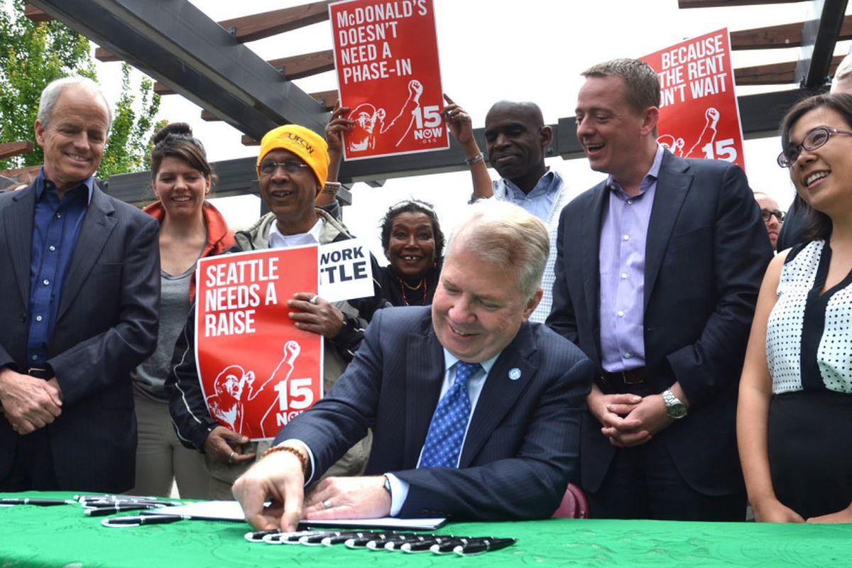 Mayor Murray signing Seattle's minimum wage legislation