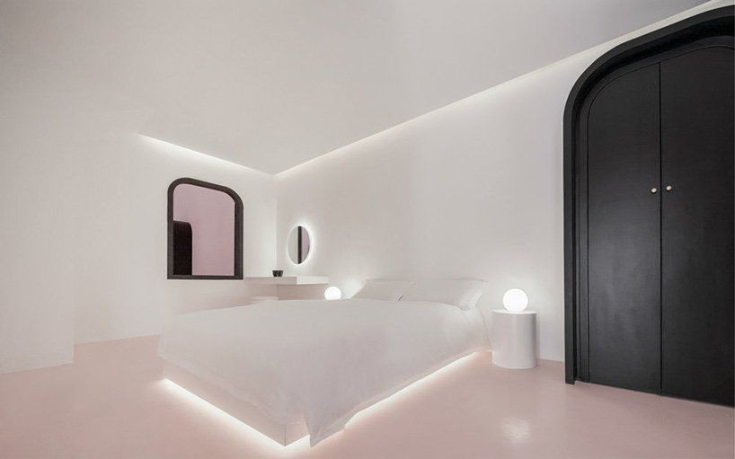 Room with pink floor and backlit bed