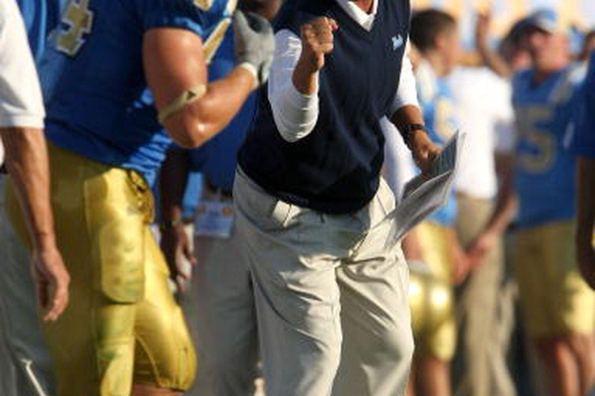 Head coach Rick Neuheisel simply must succeed as the UCLA head football coach. (Photo by Stephen Dunn/Getty Images)