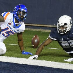 Boise State cornerback Jalen Walker (15) breaks up a pass intended for Utah State wide receiver Siaosi Mariner (80) during the first half of an NCAA college football game Saturday, Nov. 23, 2019, in Logan, Utah.