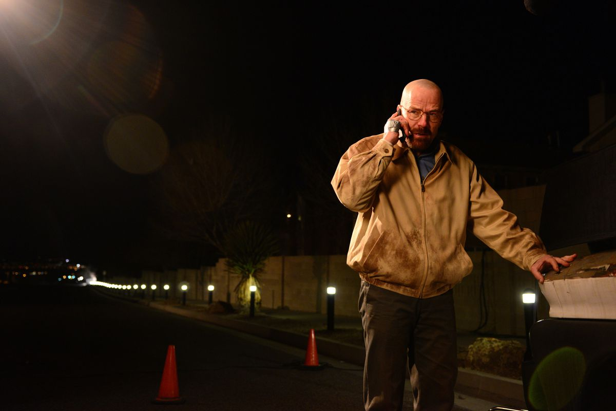 Actor Bryan Cranston as Walter White holds a phone to his ear in Breaking Bad.