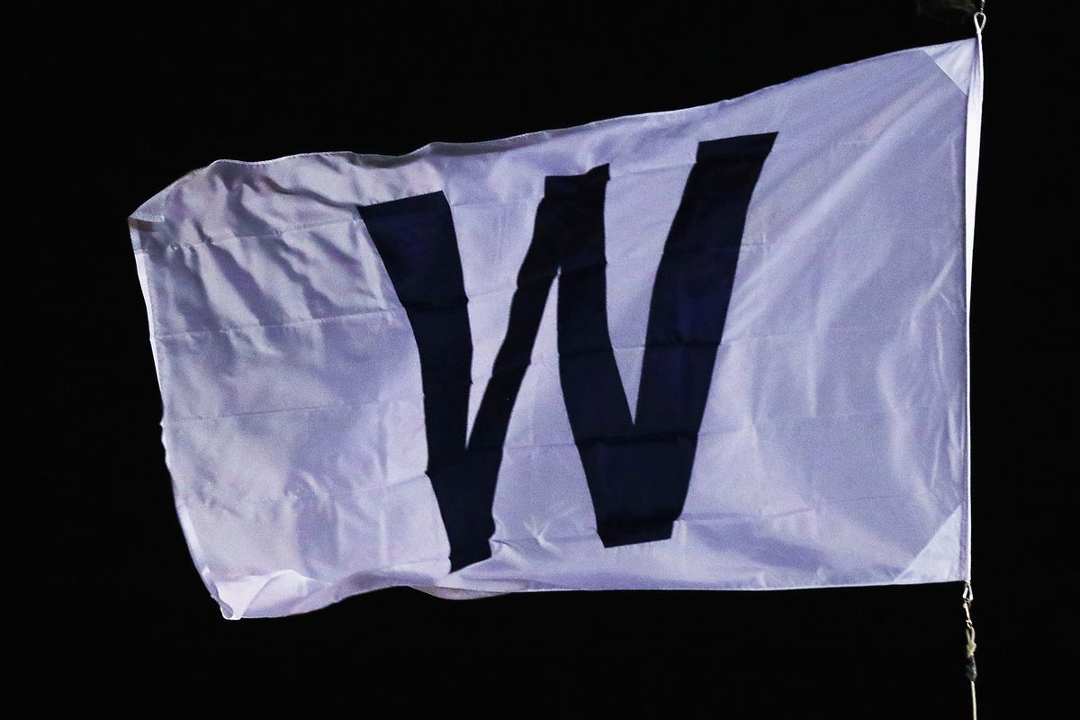"""CHICAGO, IL - OCTOBER 18:  A general view of the """"W"""" flag flying after the Chicago Cubs beat the Los Angeles Dodgers 3-2 in game four of the National League Championship Series at Wrigley Field on October 18, 2017 in Chicago, Illinois.  (Photo by Stacy Revere/Getty Images)"""