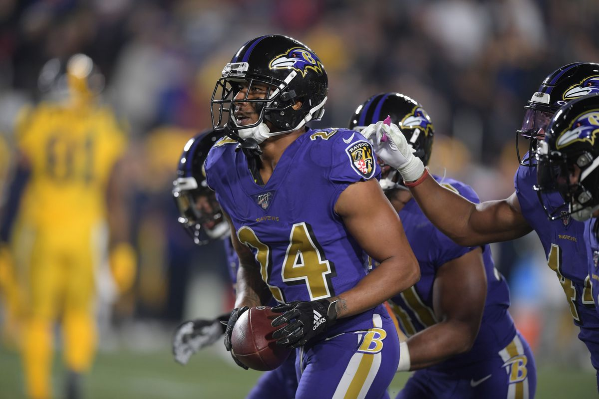 Baltimore Ravens cornerback Marcus Peters celebrates with teammates after intercepting a pass in the fourth quarter against the Los Angeles Rams at Los Angeles Memorial Coliseum.