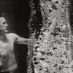 """A boxer hits a punching bag in an old piece of film, but the deterioration of the celluloid gives it an ethereal look in the experimental film """"Decasia,"""" part of a newly released DVD box set, """"Bill Morrision: Collected Works (1996-2013)."""""""