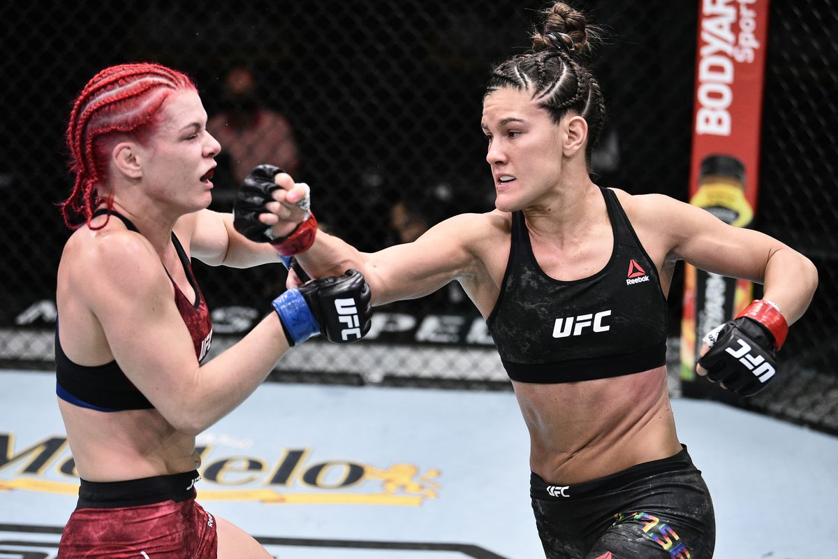 In this handout image provided by UFC, Cortney Casey punches Gillian Robertson or Canada in their flyweight bout during the UFC Fight Night event at UFC APEX on June 20, 2020 in Las Vegas, Nevada.
